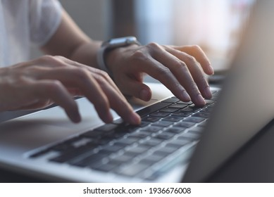 Close up image of woman hands typing on laptop computer keyboard and surfing the internet on office table, online, working, business and technology, internet network communication concept