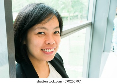 Close up image of young asian women smile.