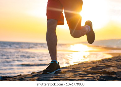 close up image of young man strong legs off trail running at amazing summer sunset in sport and healthy lifestyle concept and jogging cross country training workout