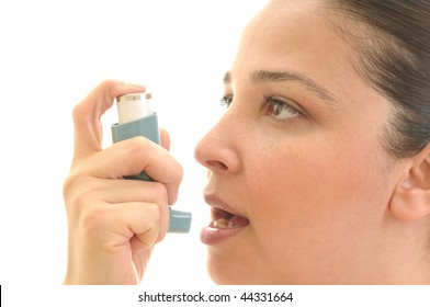 Close up image of a young woman using inhaler for asthma. White background studio picture