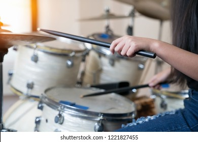 Close up images of girl playing drum.