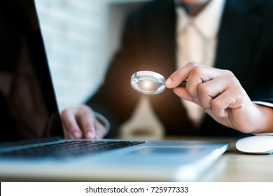Close up images of magnifying glass In the hands of a business woman , searching, online shopping, and business concept