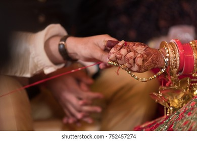 close up of indian bride hands during wedding day