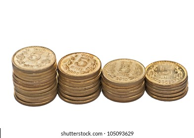 Close up of Indian Coin stack, 5 rupees, isolated on white background, placed diagonally, copy space,
