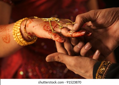 Close up of Indian couple's hands at a wedding, concept of marriage/partnership/commitment