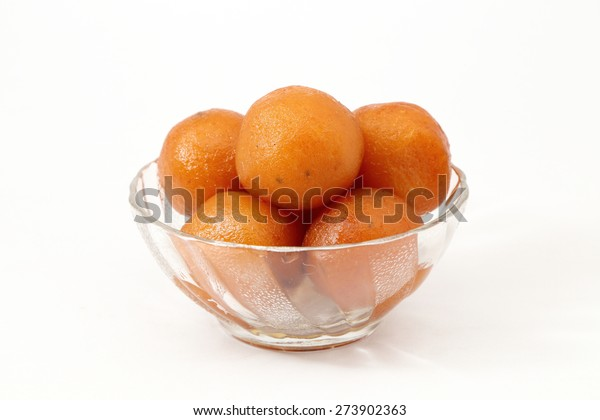 close up of indian dessert or sweet gulab jamun in a glass bowl isolated on white background