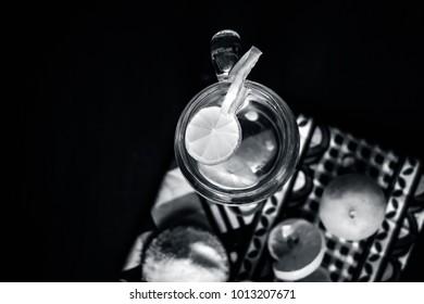 Close up of Indian most popular summer drink Nimbu pani or Nimbo sarbat,Lemonade in a transparent glass with salt.