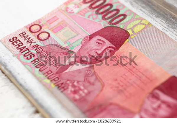Close up of Indonesian money, 100,000 IDR banknotes, finance concept
