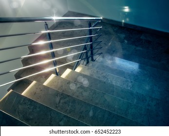 close up indoor granite staircase of a building