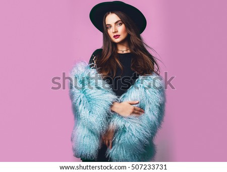 9afe5deccdfc Close up indoor studio fashion portrait of gorgeous woman in stylish winter  fluffy blue coat and