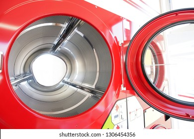 close up of industrial laundry machine in a public laundromat