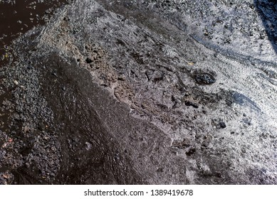 Close up of industrial liquid waste from refinery - oil sludge