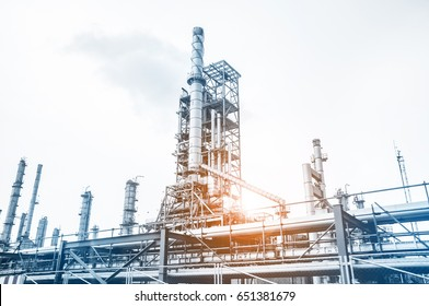 Close up Industrial view at oil refinery plant form industry zone with white sky and sunrise sky background