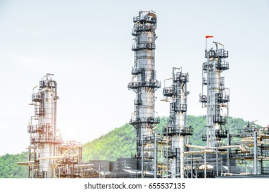 Close up Industrial view at oil refinery plant form industry zone with blue sky and sunrise sky background
