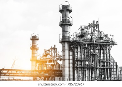 Close up Industrial zone. Plant oil and gas refinery industry. Petrochemical factory  area with the sunlight sky background.