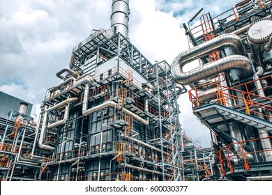 close up Industrial zone,The equipment of oil refining,Close-up of industrial pipelines of an oil-refinery plant,Detail of oil pipeline with valves in large oil refinery, power energy system station.