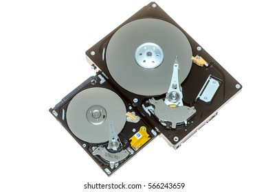 """Close up inside of 2.5"""" and 3.5"""" computer hard disk drives HDD isolated on white background"""
