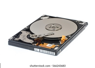 """Close up inside of 2.5"""" computer disk drive HDD isolated on white background"""