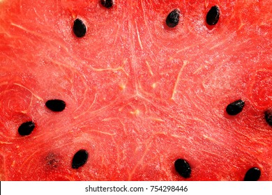 close up inside of watermelon, red surface with black seeds have copy space for put text