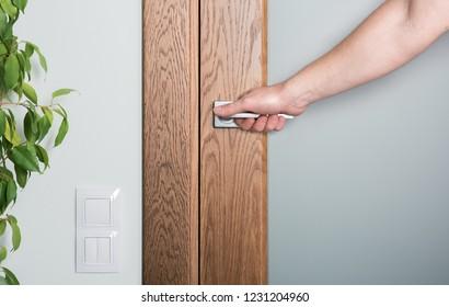 Close - up of interior elements. Open the door. Man's hand on the door handle