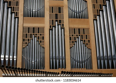Close up interior view of the iberian organ located in saints-françois church, in Montpellier city, southern France. September, 16, 2018. Classical wooden musical instrument with vertical iron pipes.