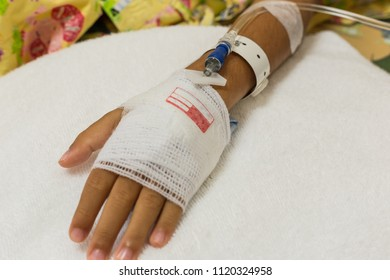 Close up intravenous (iv) set saline drip on children hand at pediatric department in hospital. Health care and Medical equipment concept.