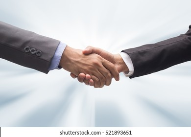 close up investor businessman handshake with partner vendor for completed job or good experience, business synergy and empower concept