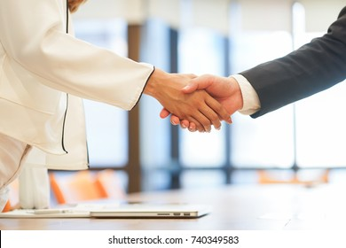 close up investor businessman handshake with partner vendor after completed acquisition ,collaboration of two ceo leader hand shake for make agreement or deal financial cooperative and synergy concept