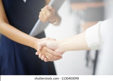 close up investor businesswoman handshake with partner vendor,collaboration of two ceo leader hand shake for agreement or deal financial cooperative concept.