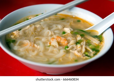 Close up of Ipoh Hor Fun, Chinese rice noodle soup with shredded chicken