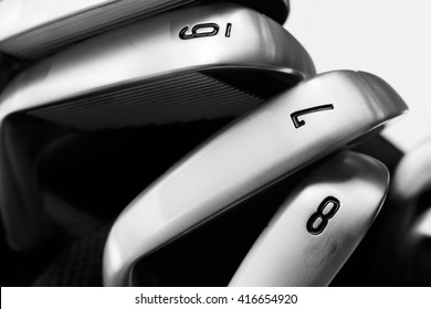 Close up iron golf clubs in black and white tone.