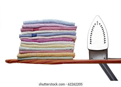 close up of ironing tool and towels on white background