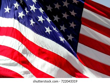 Close up isolated colorful United states of American U.S. flag with stars and stripes red white and blue