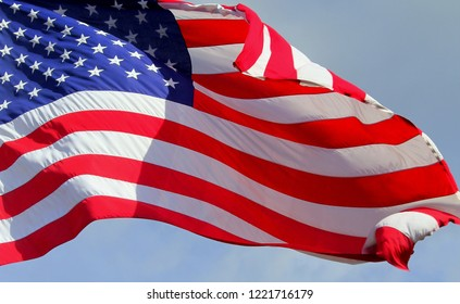 Close up isolated colorful waving rippled United states of American U.S. flag with stars and stripes red white and blue 4th of July