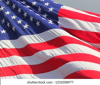 Close up isolated colorful waving rippling United states of American U.S. flag with stars and stripes red white and blue 4th of July