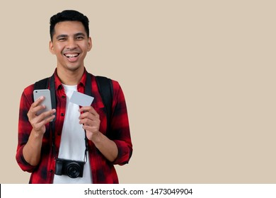 close up isolated of young hipster handsome man hand holding smartphone and blank white credit card (for design) with happiness feeling on cream background,lifestyle people in the summer  concept
