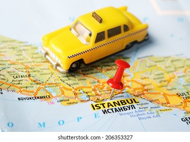 Close up of  Istanbul ,Turkey  map with red pin  and a taxi  - Travel concept