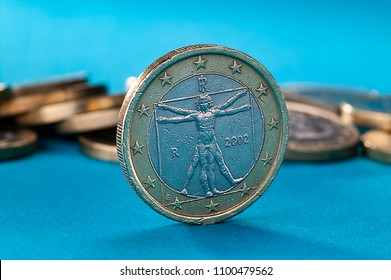 Close up of an italian euro coin, used, on blue background, The Vitruvian man,