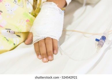Close up IV set on children hand at pediatric unit in hospital.Medical treatment concept.