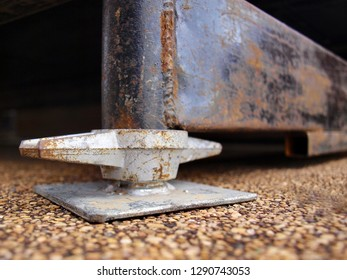 Close up the jack base or scaffolding steel base. Adjustable strength. Used to support weight on scaffolding and used in construction areas. On the background, rancid floor, brown gravel.soft focus