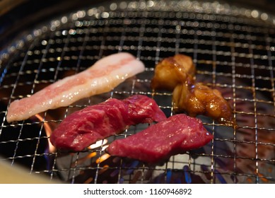 Close up of Japan local beef and innard or horumon grilled on the oven in Japanese yakiniku restuarant Tokyo Japan.