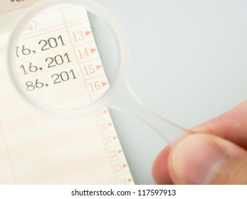 Close up Japanese bankbook with glasses