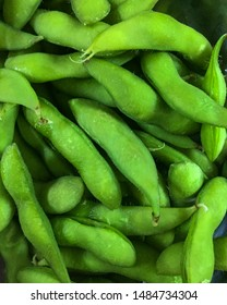 Close up of Japanese cuisine edamame bean. Fresh steamed edamame. Full picture filled with cooked unpeel edamame bean. Green and healthy edamame is a popular side dish at Japanese restaurants. - Image
