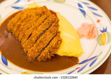 close up Japanese curry omurice with deep fired pork cutlet