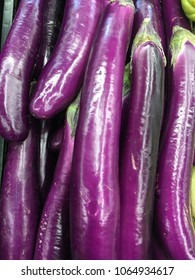 Close up of Japanese eggplants at the market