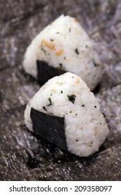 Close up of Japanese rice ball (onigiri) on seaweed.