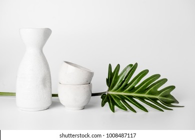 Close up of Japanese Sake drinking set on a white background.