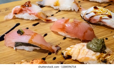The close up of Japanese sushi set on wooden board in Japan restaurant.