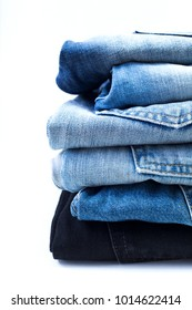 Close up of jeans on a white background