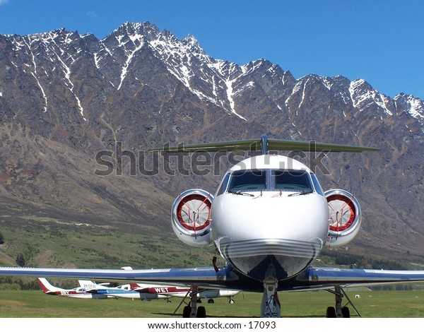 close up of a jet with remarkables in queenstown in the back ground